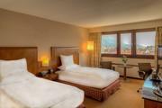 Hilton Innsbruck - Double Queen Mountain View Deluxe Zimmer © Hilton Innsbruck
