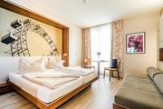 JUFA Hotel Wien City - Bett Doppelzimmer Bild Riesenrad © JUFA Hotel Wien City