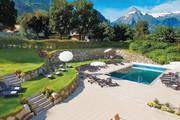 Das Alpenhaus Kaprun - Aussenanlage mit Pool © Alpenhaus Kaprun