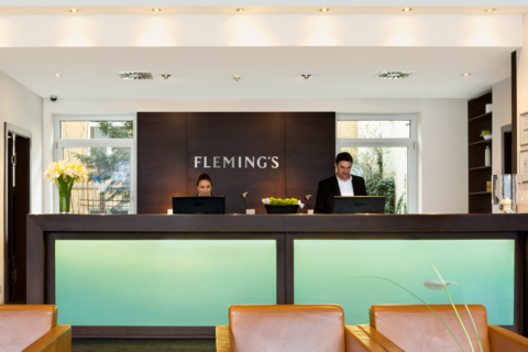 Fleming's Conference Hotel Wienr- Rezeption mit Miarbeitern © Fleming's Conference Hotel Wien